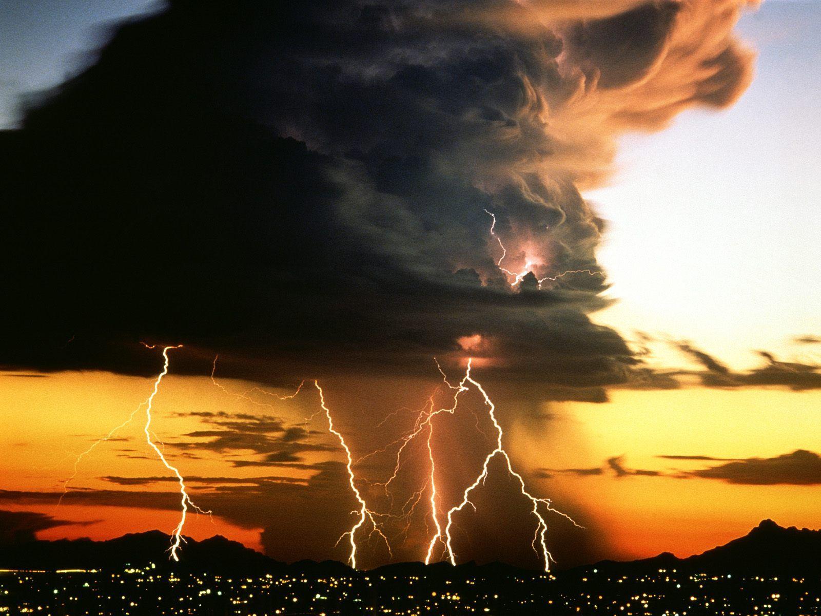 Lightning Storm Over City Lights